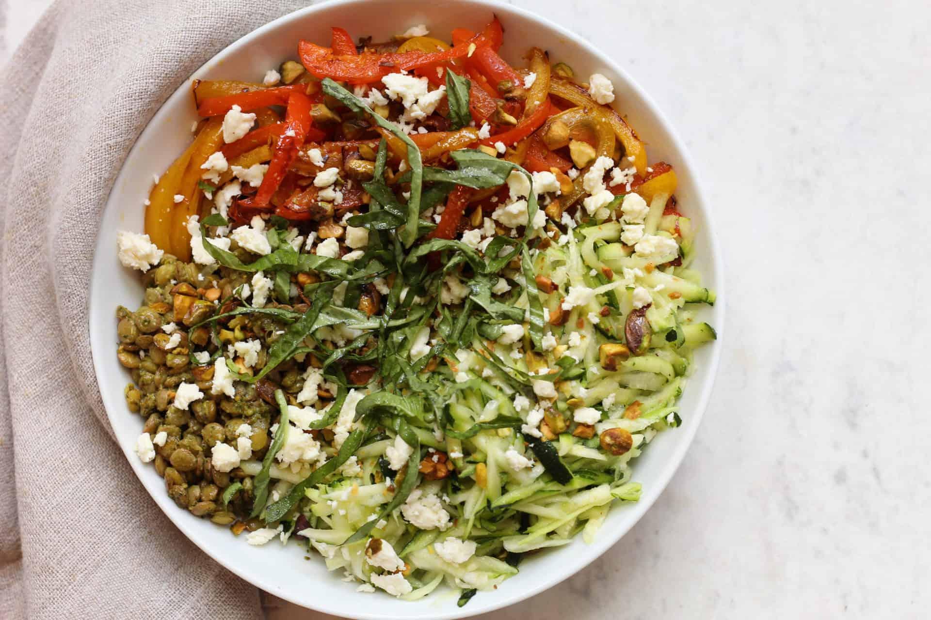 green lentil bowl with pistachio pesto
