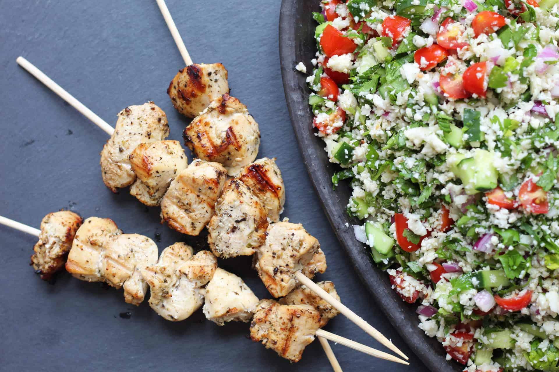 lemony chicken kebobs over cauliflower tabbouleh